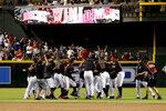 The Arizona Diamondbacks celebrate after defeating the Boston Red Sox in a baseball game, Saturday, April 6, 2019, in Phoenix. (AP Photo/Rick Scuteri)