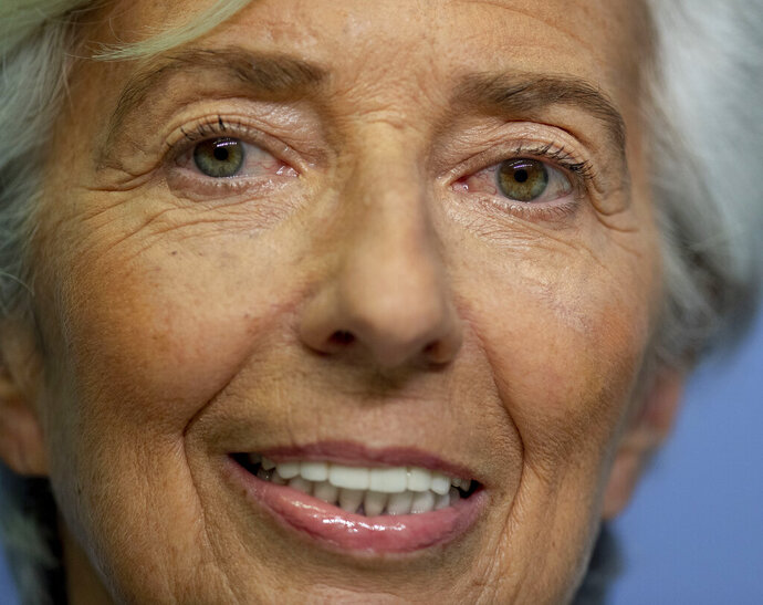 President of European Central Bank Christine Lagarde smiles prior to a press conference following a meeting of the governing council in Frankfurt, Germany, Thursday, Jan. 23, 2020. (AP Photo/Michael Probst)