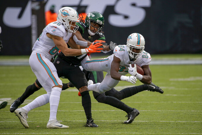 Miami Dolphins wide receiver Isaiah Ford (84) comes down with a catch against the New York Jets during the third quarter of an NFL football game, Sunday, Dec. 8, 2019, in East Rutherford, N.J. (AP Photo/Seth Wenig)