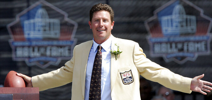 FILE - In this Aug. 7, 2005, file photo, former Miami Dolphins quarterback Dan Marino gets ready to throw a pass during a speech at the NFL Football Hall of Fame in Canton, Ohio. The Dolphins and coach Don Shula were surprised when Marino remained on the board when their turn came with the 27th overall pick at the NFL Draft. (AP Photo/Tony Dejak, File)
