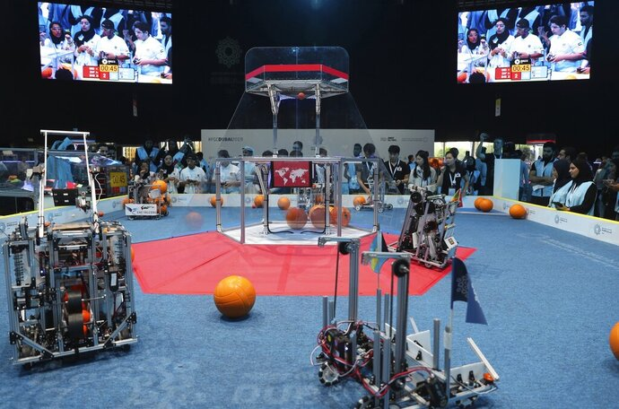 FILE- In this Friday, Oct. 25, 2019 file photo, a team from Korea, on the right, competes with UAE Falcons during the First Global Challenge, a robotics and artificial intelligence competition in Dubai, United Arab Emirates. Israel's prime minister is greeting the country's triumphant teen delegation to the unofficial