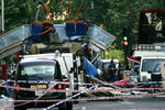 FILE - In this July 7, 2005 file photo file photo the wreckage of a double-decker bus with its top blown off by a bomb and damaged cars scattered on the road at Tavistock Square in central London. In the 20 years since the Sept. 11, 2001 terrorist attacks in the United States, a mixture of homegrown extremists, geography and weaknesses in counterterrorism strategies have combined to turn Europe into a prime target for jihadists bent on hurting the West. (AP Photo/Sang Tan, File)