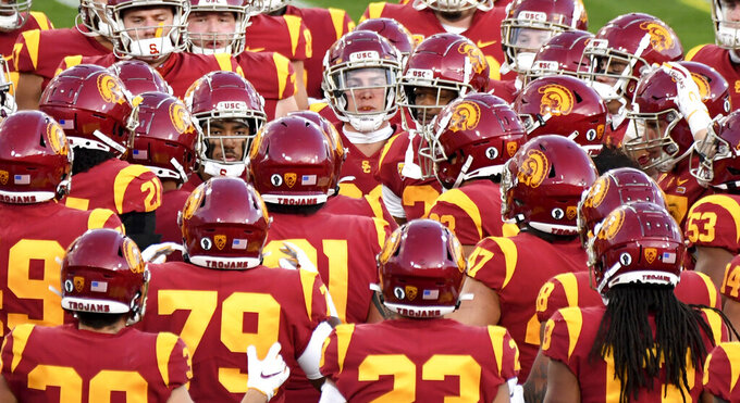 CORRECTS TO PASADENA, INSTEAD OF LOS ANGELES Southern California player gather before an NCAA college football game against UCLA on Saturday, Dec. 12, 2020, in Pasadena, Calif. (Keith Birmingham/The Orange County Register via AP)