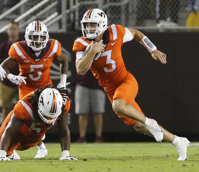 Virginia Tech quarterback Braxton Burmeister (3) runs for a first down against North Carolina NCAA during the second half of an NCAA college football game Friday, Sept. 3, 2021, in Blacksburg, Va. (Matt Gentry/The Roanoke Times via AP)