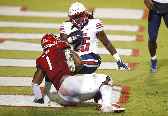 North Carolina State linebacker Isaiah Moore (1) tackles Liberty running back Peytton Pickett (25) in the end zone for a safety during the second half of an NCAA college football game Saturday, Nov. 21, 2020, in Raleigh, N.C. (Ethan Hyman/The News & Observer via AP, Pool)