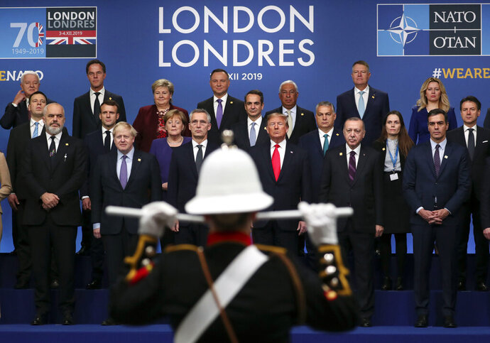 NATO heads of state attend a ceremony event during a NATO leaders meeting at The Grove hotel and resort in Watford, Hertfordshire, England, Wednesday, Dec. 4, 2019. NATO Secretary-General Jens Stoltenberg rejected Wednesday French criticism that the military alliance is suffering from brain death, and insisted that the organization is adapting to modern challenges. (Steve Parsons/PA via AP)