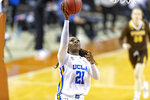 UCLA forward Michaela Onyenwere scores against Wyoming during the first half of a college basketball game in the first round of the women's NCAA tournament at the Frank Erwin Center in Austin, Texas, Monday, March 22, 2021. (AP Photo/Stephen Spillman)