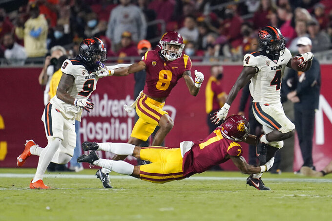 Oregon State running back B.J. Baylor (4) runs past Southern California safety Chase Williams (7) during the second half of an NCAA college football game Saturday, Sept. 25, 2021, in Los Angeles. (AP Photo/Marcio Jose Sanchez)