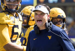 West Virginia head coach Neal Brown yells at a referee during the second half of an NCAA college football game against North Carolina State Saturday, Sept. 14, 2019, in Morgantown, W.Va. (AP Photo/Raymond Thompson)
