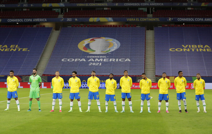 Brazil's players stand during the national anthem prior to a Copa America soccer match against Venezuela at the National Stadium in Brasilia, Brazil, Sunday, June 13, 2021. (AP Photo/Eraldo Peres)
