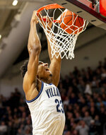 Villanova forward Jermaine Samuels (23) dunks during the first half of an NCAA college basketball game against Xavier, Monday, Dec. 30, 2019, in Villanova, Pa. (AP Photo/Laurence Kesterson)