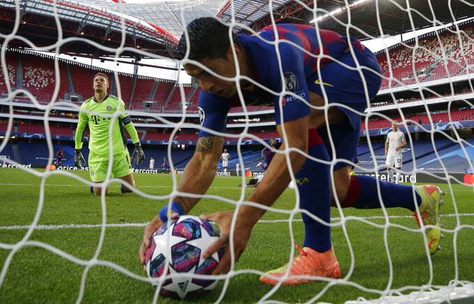 Barcelona's Luis Suarez, right, picks up the ball from a net after Bayern's goalkeeper Manuel Neuer failed to make a save during the Champions League quarterfinal match between FC Barcelona and Bayern Munich at the Luz stadium in Lisbon, Portugal, Friday, Aug. 14, 2020. (AP Photo/Manu Fernandez/Pool)