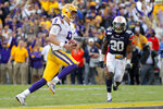 LSU quarterback Joe Burrow (9) carries for a touchdown in front of Auburn defensive back Jeremiah Dinson (20) in the second half of an NCAA college football game in Baton Rouge, La., Saturday, Oct. 26, 2019. (AP Photo/Gerald Herbert)