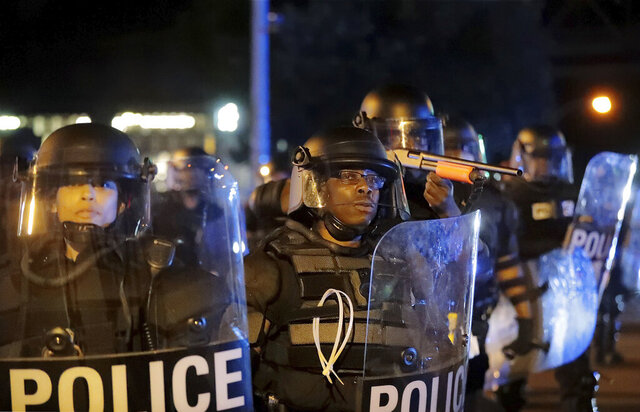 Memphis Police officers point a gun at a group of demonstrators, Monday, June 1, 2020, as they protest the death of George Floyd who died in Minneapolis police custody May 25, 2020. (Daily Memphian via AP)