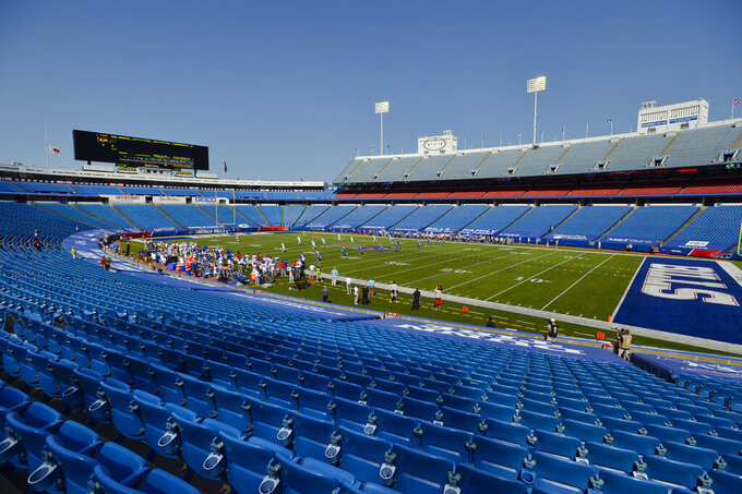 FILE - In this Sept. 27, 2020, file photo, the Buffalo Bills play the Los Angeles Rams during the first half of an NFL football game in Orchard Park, N.Y. The New York health commissioner is considering whether to allow 6,700 fans to attend a rare Bills home playoff game if all attendees are tested beforehand. But nothing has been finalized yet, according to Gov. Andrew Cuomo and a spokesperson for the Bills. The playoffs begin the weekend of Jan. 9, but the date of the game isn't set. (AP Photo/Adrian Kraus, File)