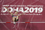 """FILE - In this file photo dated Monday, Sept. 30, 2019, participating as a neutral athlete Mariya Lasitskene clears the bar during the women's high jump finals at the World Athletics Championships in Doha, Qatar.  Sanctions handed down by the World Anti-Doping Agency on Monday Dec. 9, 2019, mean there won't be a Russian flag or anthem, but athletes including Lasitskene said she's still aiming for the Tokyo Olympics,""""I didn't believe the stories that everything will be fine. What has happened today is a disgrace,"""