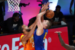 Denver Nuggets' Nikola Jokic (15) is fouled by Utah Jazz's Rudy Gobert during the second half of an NBA basketball first round playoff game Sunday, Aug. 30, 2020, in Lake Buena Vista, Fla. (AP Photo/Ashley Landis)