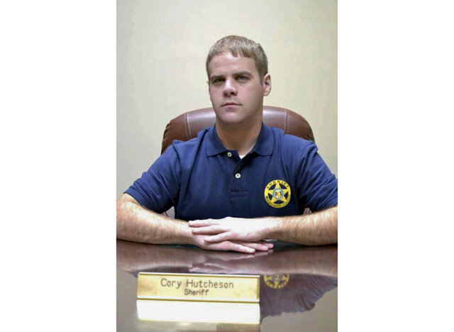 FILE - In this undated file photo, then Mississippi County Sheriff Cory Hutcheson sits behind his desk at the Mississippi County Detention Center in Charleston, Mo. The Missouri NAACP and black lawmakers are calling for a new investigation into the 2017 death of Tory Sanders. Sanders was being held at the Mississippi County Jail, in Charleston, and the sheriff at the time, Hutcheson, was accused of pressing his knee against Sanders' neck for up to three minutes. (Leonna Heuring/Sikeston Standard Democrat via AP, File)
