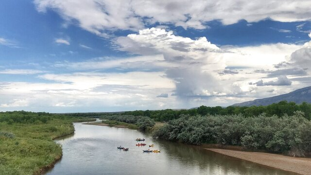 This May 31, 2020 image shows a group of kayakers making their way down the Rio Grande between Rio Rancho and Albuquerque, New Mexico. One of New Mexico's largest drinking water providers has decided to stop diverting water from the Rio Grande to help prevent the stretch that runs through Albuquerque from going dry this summer. (AP Photo/Susan Montoya Bryan)