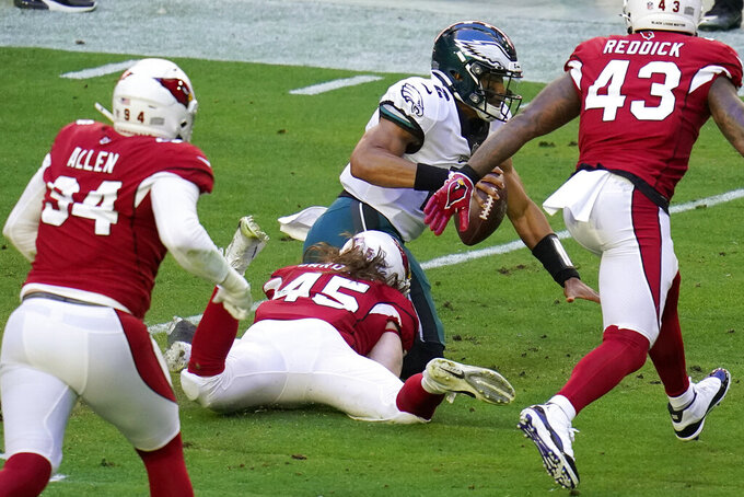 Arizona Cardinals linebacker Dennis Gardeck (45) sacks Philadelphia Eagles quarterback Jalen Hurts (2) during the first half of an NFL football game, Sunday, Dec. 20, 2020, in Glendale, Ariz. (AP Photo/Ross D. Franklin)
