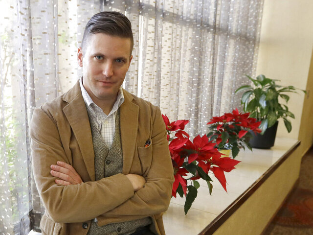"""FILE – In this Dec. 6, 2016, file photo, white nationalist Richard Spencer poses between interviews in College Station, Texas. A judge in Montana has told  Spencer that he faces two weeks in a county jail if he doesn't reach a plan this week to pay off a legal debt stemming from his divorce case, according to court records. On Wednesday, June 17, 2020 Spencer said """"I have every confidence that we will reach an agreement and this will be quickly forgotten and under the bridge"""