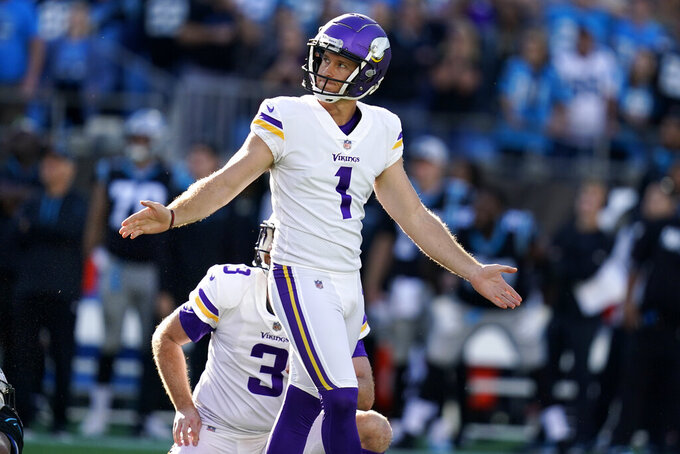 Minnesota Vikings kicker Greg Joseph (1) reacts to missing a game-winning field goal against the Carolina Panthers during the second half of an NFL football game, Sunday, Oct. 17, 2021, in Charlotte, N.C. The Minnesota Vikings won 34-28 in overtime. (AP Photo/Gerald Herbert)