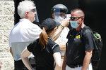Iowa medical personal screen an attendee before a news conference with Iowa football coach Kirk Ferentz, Friday, June 12, 2020, in Iowa City, Iowa. The Iowa football team took a big step toward improving its lines of communication in the week since the program was hit with allegations of systemic racism, Ferentz and three of his players said Friday. (AP Photo/Charlie Neibergall)