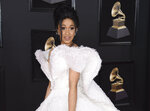 FILE - In this Jan. 28, 2018 file photo, Cardi B arrives at the 60th annual Grammy Awards in New York. The 25-year-old rapper welcomed Kulture Kiari Cephus during a post on Instagram Wednesday, July 11. The girl was born Tuesday. (Photo by Evan Agostini/Invision/AP, File)