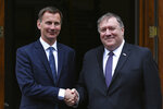 US Secretary of State Mike Pompeo, right, is greeted by Britain's Foreign Secretary Jeremy Hunt in central London, Wednesday May 8, 2019. U.S. Secretary of State Mike Pompeo is in London for talks with British officials on the status of the special relationship between the nations amid heightened tensions with Iran and uncertainty over Britain's exit from the European Union. (Mandel Ngan/Pool via AP)