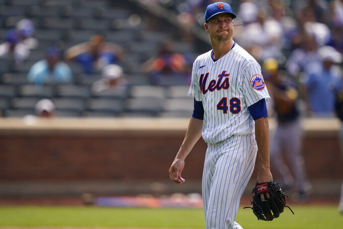 New York Mets starting pitcher Jacob deGrom (48) reacts as he leaves the field after the fifth inning of the first baseball game of a doubleheader against the Milwaukee Brewers, Wednesday, July 7, 2021, in New York. (AP Photo/Frank Franklin II)