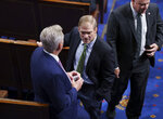 Rep. Jim Jordan, R-Ohio, center, speaks with House Minority Leader Kevin McCarthy, R-Calif., left, in the House chamber during the vote to create a select committee to investigate the Jan. 6 insurrection, at the Capitol in Washington, Wednesday, June 30, 2021. (AP Photo/J. Scott Applewhite)