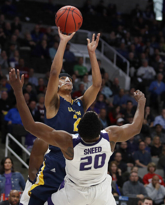 UC Irvine guard Eyassu Worku, top, shoots over Kansas State forward Xavier Sneed (20) during the first half of a first round men's college basketball game in the NCAA Tournament Friday, March 22, 2019, in San Jose, Calif. (AP Photo/Ben Margot)
