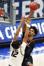 Georgia's Justin Kier shoots against Missouri's Dru Smith (12) in the first half of an NCAA college basketball game in the Southeastern Conference Tournament Thursday, March 11, 2021, in Nashville, Tenn. (AP Photo/Mark Humphrey)