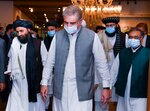 In this photo provided by Pakistan's Ministry of Foreign Affairs, Foreign Minister Shah Mahmood Qureshi, center, walks with members of a Taliban political team on their arrival at the Foreign Ministry for talks, in Islamabad, Pakistan, Tuesday, Aug. 25, 2020. The team arrived in Pakistan on Monday as efforts appear to be ramping up to get negotiations underway between the Afghan government and the insurgents. The start of the talks, envisaged under a U.S.-Taliban peace agreement signed in February, was hampered by a series of delays that have frustrated Washington. (Pakistan Ministry of Foreign Affairs via AP)