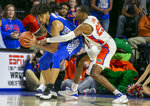 Kentucky forward Nick Richards (4) steals the ball from Florida guard Scottie Lewis (23) during the second half of an NCAA college basketball game Saturday, March 7, 2020, in Gainesville, Fla. (AP Photo/Alan Youngblood)