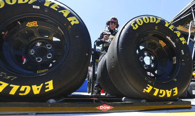 A pit crew member for NASCAR Xfinity Series driver Tyler Reddick (2) checks tires during the NASCAR XFinity Series auto race, Saturday, April 27, 2019, at Talladega Superspeedway in Talladega, Ala. (AP Photo/Julie Bennett)