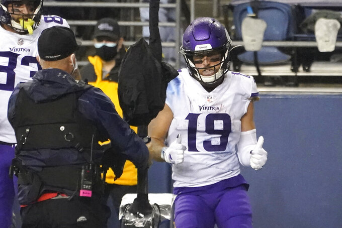 Minnesota Vikings wide receiver Adam Thielen mugs for a camera after scoring a touchdown against the Seattle Seahawks during the second half of an NFL football game, Sunday, Oct. 11, 2020, in Seattle. (AP Photo/Ted S. Warren)