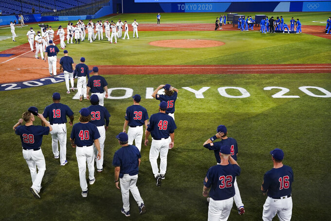 Team United States walk out to shake hands with team Japan after the gold medal baseball game at the 2020 Summer Olympics, Saturday, Aug. 7, 2021, in Yokohama, Japan. Japan won 2-0.(AP Photo/Jae C. Hong)