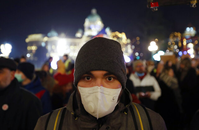 A man wearing a face mask attends during a protest against the high levels of air pollution in Belgrade, Serbia, Friday, Jan. 17, 2020. Cities throughout the Balkans have been hit by dangerous levels of air pollution in recent days, prompting residents' anger and government warnings to stay indoors and avoid physical activity. (AP Photo/Darko Vojinovic)