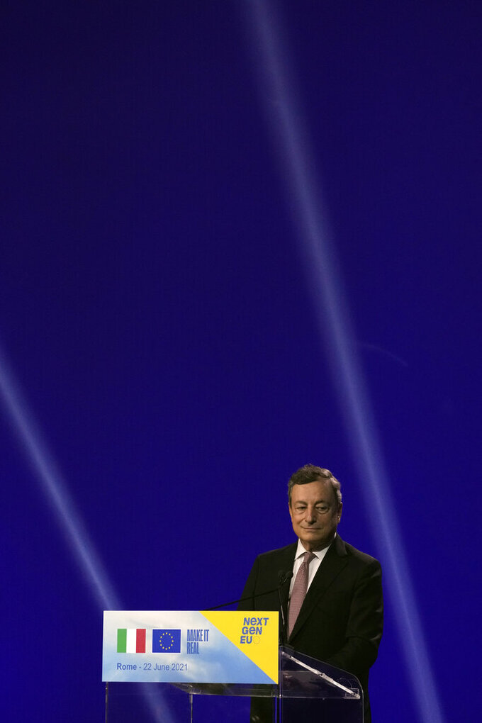 Italian Premier Mario Draghi speaks to the media during a joint news conference with European Commission President Ursula von der Leyen, at the Cinecitta' studios in Rome, Tuesday, June 22, 2021. (AP Photo/Andrew Medichini)