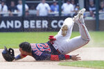 Boston Red Sox's Jose Iglesias (12) loses his helmet as he slides into second base against the Chicago White Sox during the sixth inning of a baseball game, Sunday, Sept. 12, 2021, in Chicago. (AP Photo/David Banks)