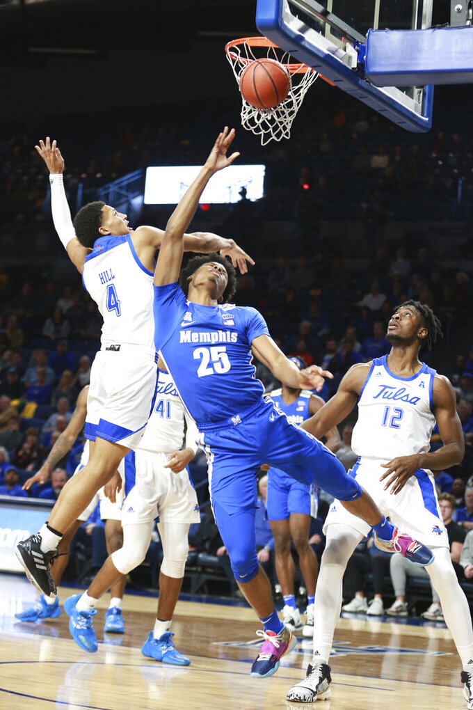 Memphis guard Jayden Hardaway (25) is fouled by Tulsa guard Isaiah Hill (4) in the first half of an NCAA college basketball game in Tulsa, Okla., Wednesday, Jan. 22, 2020. (AP Photo/Joey Johnson)