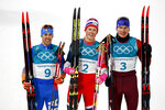 Gold medal winner Johannes Hoesflot Klaebo, of Norway, is flanked by silver medal winner Federico Pellegrino, of Italy, left, and bronze medal winner Alexander Bolshunov, of the team from Russia, after the men's cross-country skiing sprint classic at the 2018 Winter Olympics in Pyeongchang, South Korea, Tuesday, Feb. 13, 2018. (AP Photo/Matthias Schrader)
