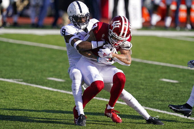 Indiana's Ty Fryfogle (3) is tackled by Penn State's Joey Porter Jr. (9) during the first half of an NCCAA college football game, Saturday, Oct. 24, 2020, in Bloomington, Ind. (AP Photo/Darron Cummings)