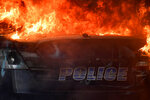 An Atlanta Police Department vehicle burns during a demonstration against police violence, Friday, May 29, 2020 in Atlanta. The protest started peacefully earlier in the day before demonstrators clashed with police. (AP Photo/Mike Stewart)