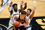 Minnesota center Liam Robbins (0) is trapped between Purdue forward Trevion Williams (50) and forward Mason Gillis (0) during the first half of an NCAA college basketball game in West Lafayette, Ind., Saturday, Jan. 30, 2021. (AP Photo/Michael Conroy)