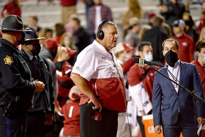 Arkansas coach Sam Pittman does his interview following the team's 24-13 win over Tennessee in an NCAA college football game Saturday, Nov. 7, 2020, in Fayetteville, Ark. (AP Photo/Michael Woods)