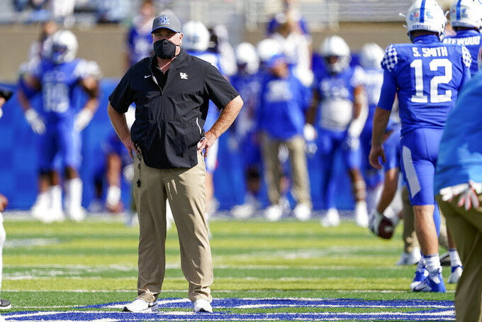 Kentucky head coach Mark Stoops watches his team warm up before an NCAA college football game against Mississippi, Saturday, Oct. 3, 2020, in Lexington, Ky. (AP Photo/Bryan Woolston)