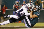 Philadelphia Eagles' Dallas Goedert (88) scores a touchdown against New England Patriots' Jonathan Jones (31) during the first half of an NFL football game, Sunday, Nov. 17, 2019, in Philadelphia. (AP Photo/Michael Perez)