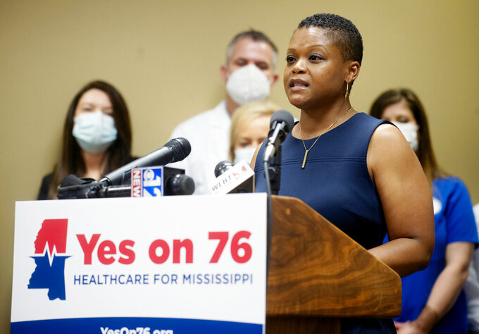 Nakeitra Burse, CEO of Six Dimensions, speaks during a press conference about the launch of the Yes on 76 campaign at the Mississippi Hospital Association in Madison, Miss., Tuesday, May 11, 2021. Doctors and health care advocates are seeking to get Medicaid expansion on the ballot. (Eric Shelton/The Clarion-Ledger via AP)